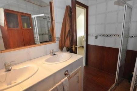 One bathroom with two basins